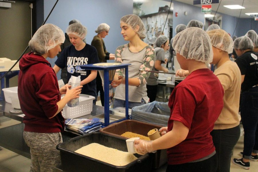 Last+year+students+and+staff+members+packed+268+boxes+of+food+at+Feed+My+Starving+Children.+%0A