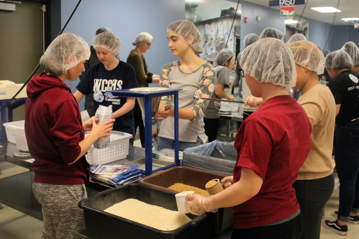 Last year students and staff members packed 268 boxes of food at Feed My Starving Children.