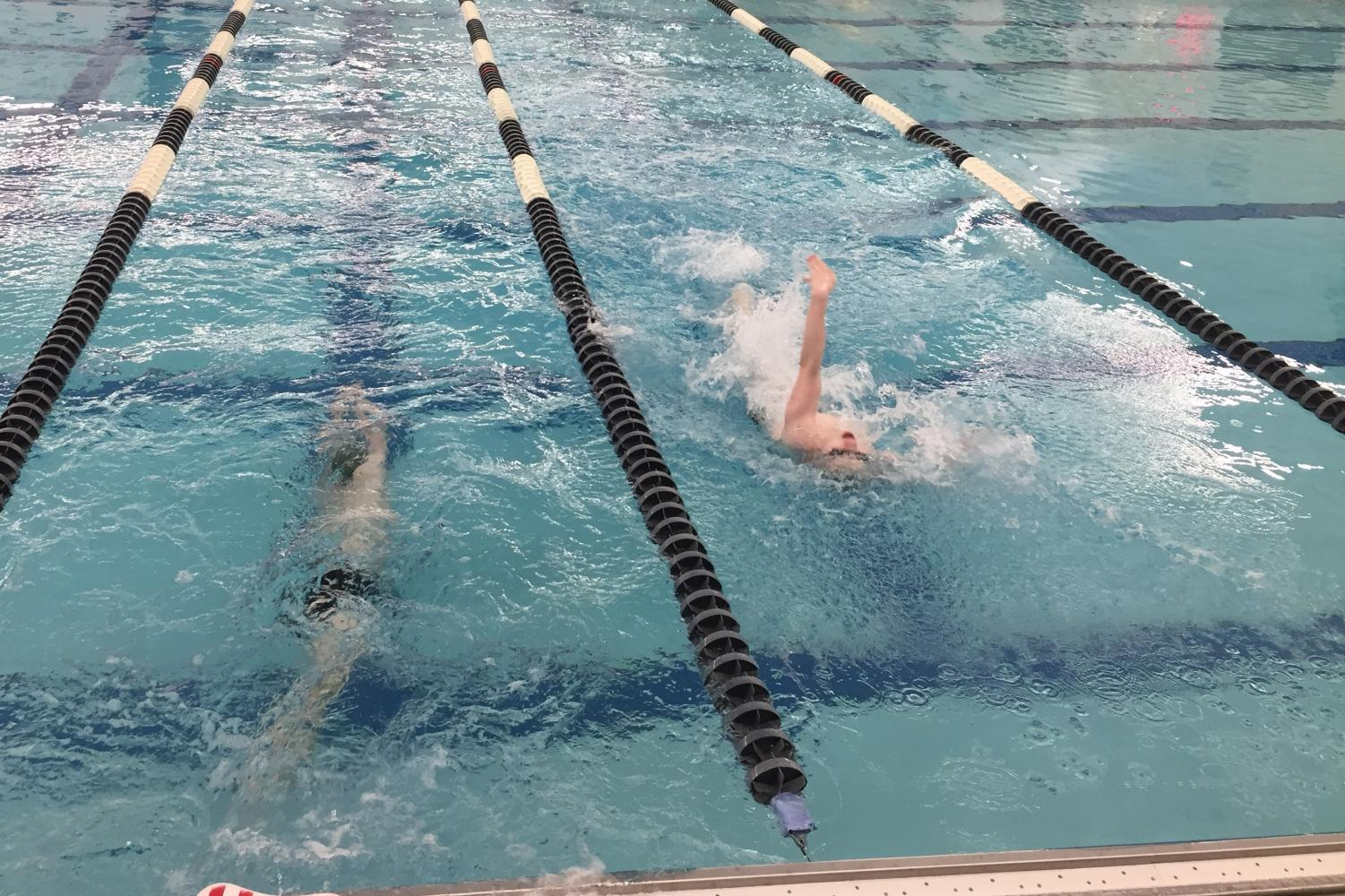 From left, Kyle Wolford and sophomore Teegan Cook practice for the state meet.