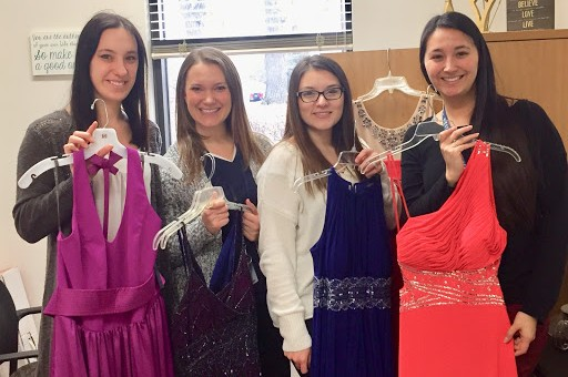 WeGo Boutique offers free dresses, shoes, jewelry, and other accessories. Counselor Julie Gawenda, from left, counselor Tracy Eier, social worker Janet Hurtado,  and counselor Deb Stack, will be helping students participating in the event.