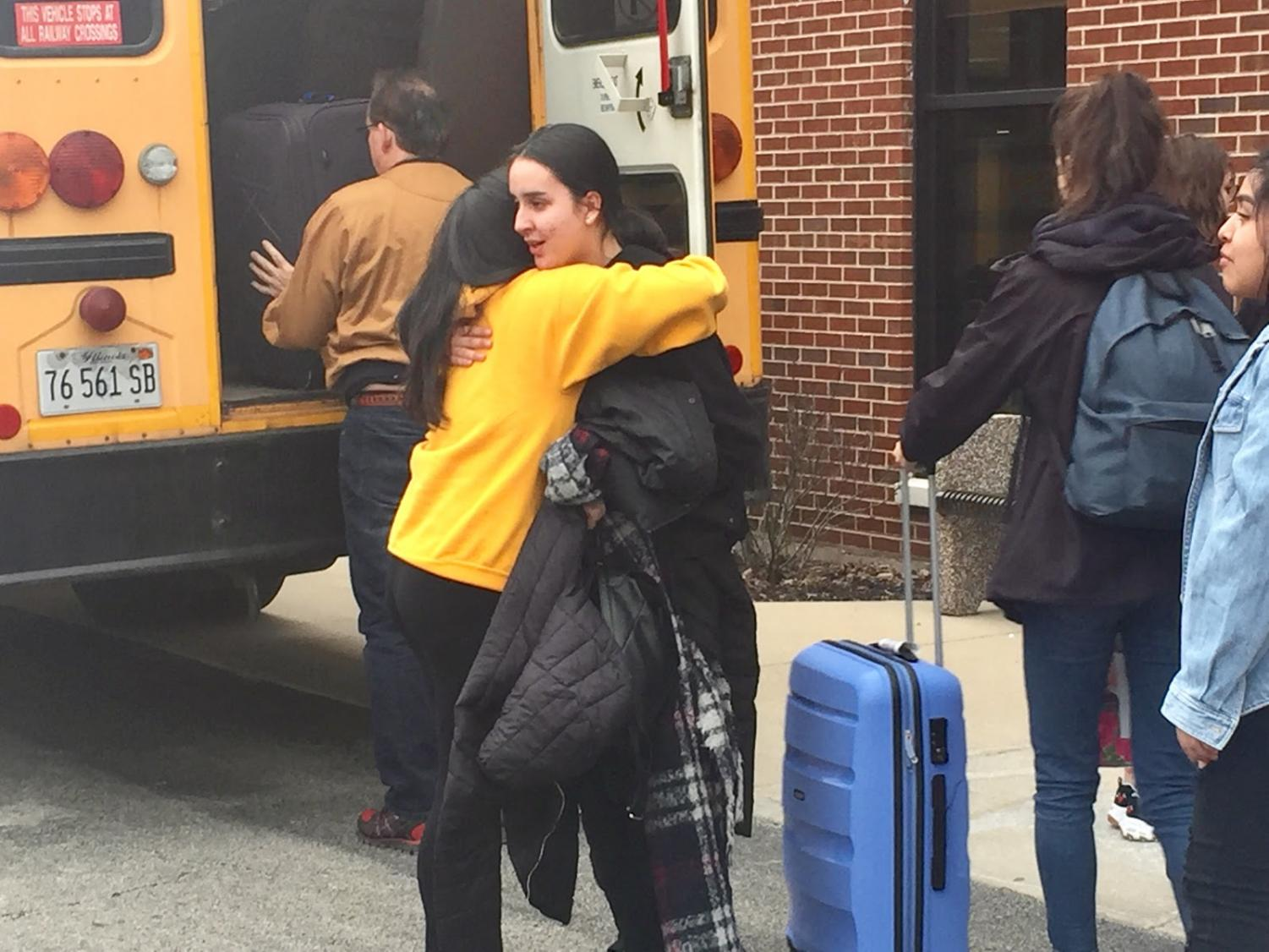 French host Guadalupe Perez give last hugs to her French exchange student Tiana Navarette before leaving for the airport Tuesday.