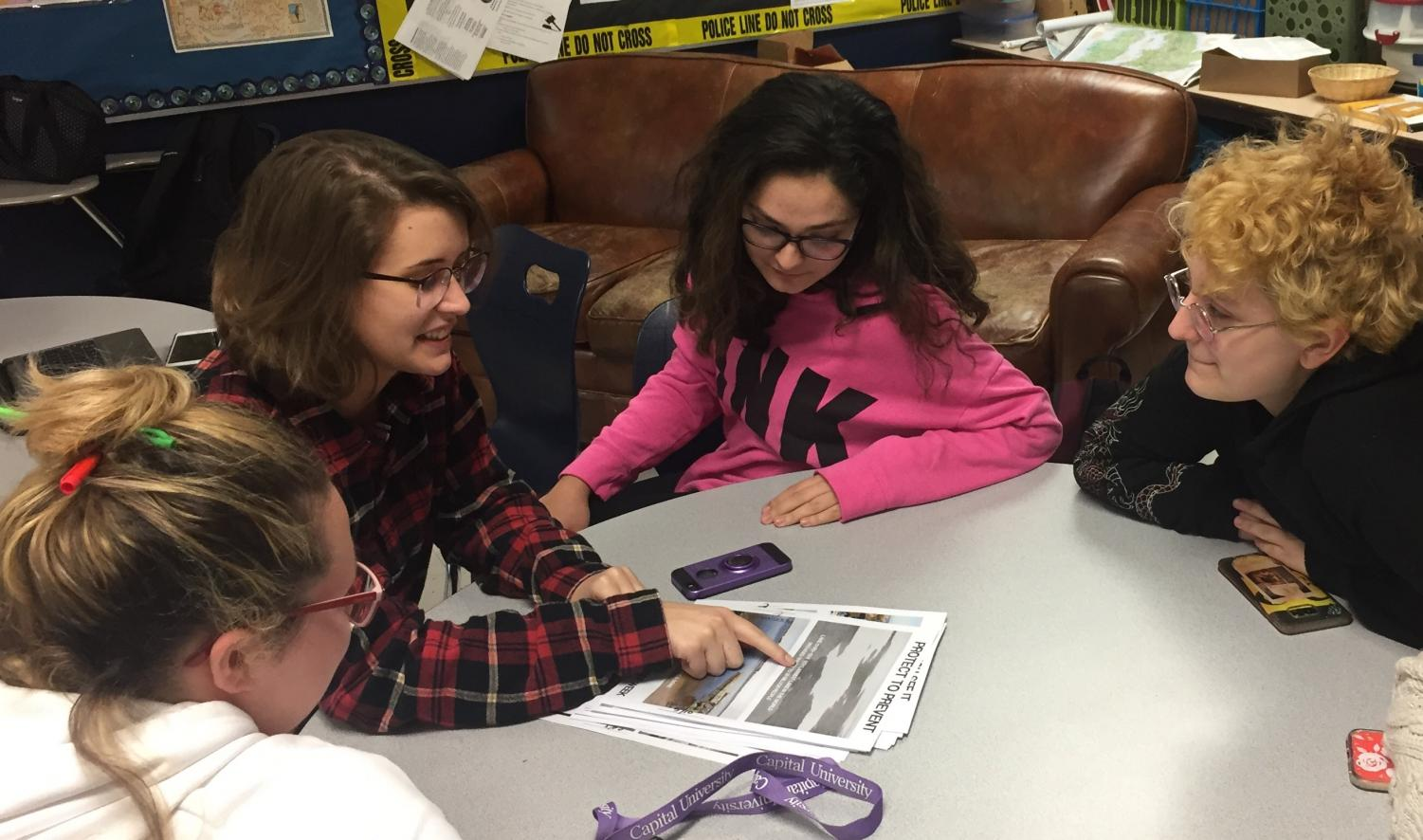 WeGo Global member Camryn Liberio explains the true or false statements to group members during their executive meeting Monday after school.