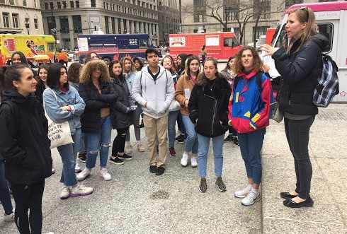 Host students, French students, and French teacher Kathryn Schoen-Stevens visited Chicago for a scavenger hunt around the Loop Friday.