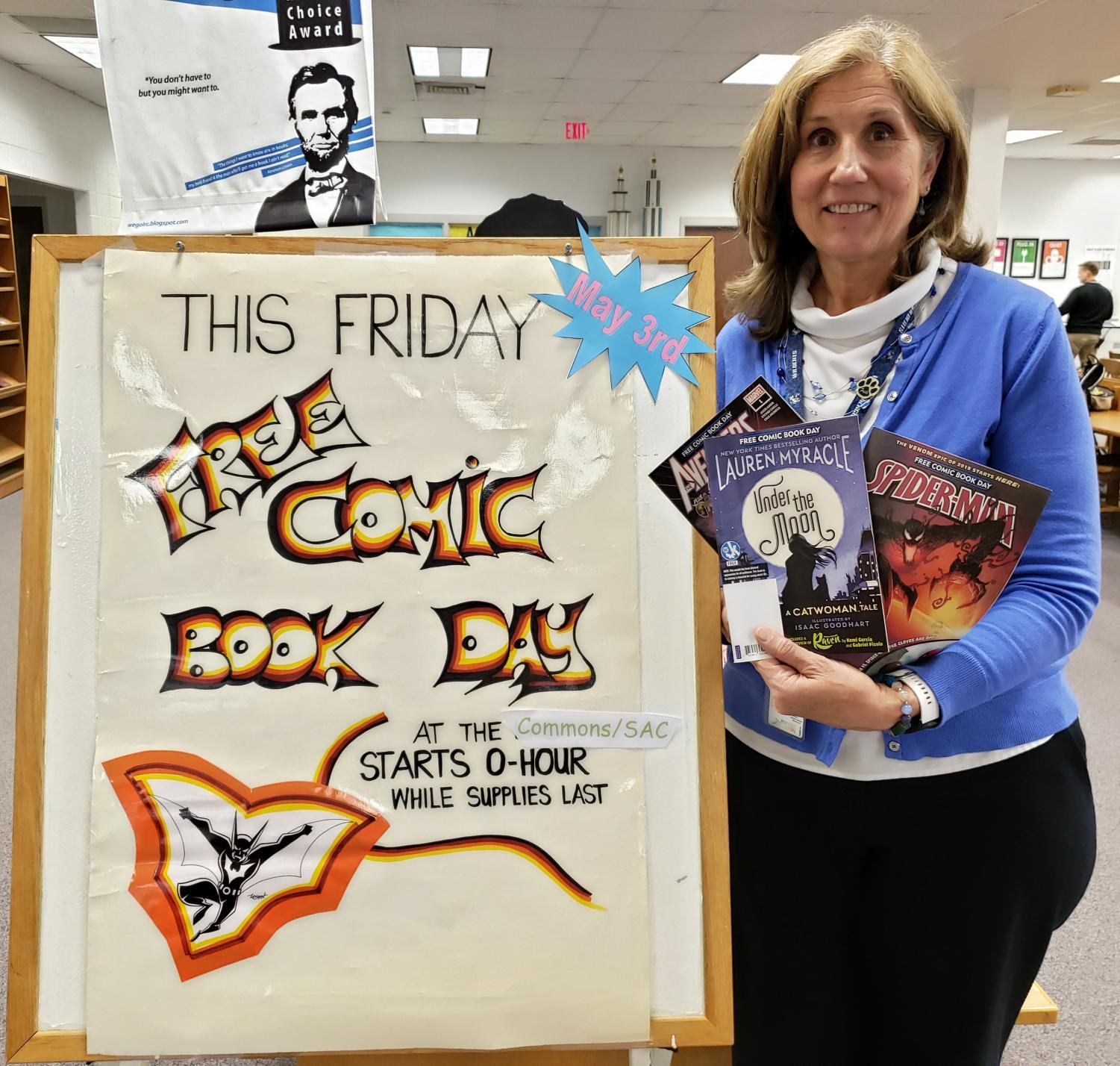 Librarian Donna Leahy holds free comics that will be given out to honor free comic book day Friday.