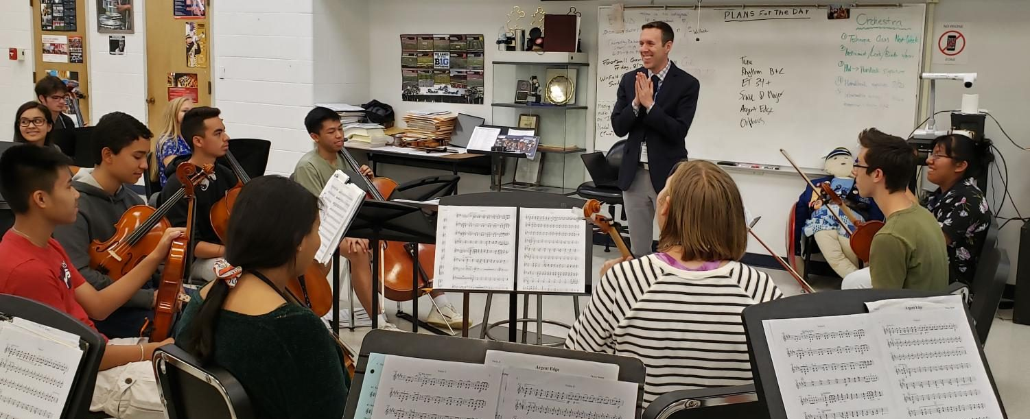 Principal Will Dwyer visits the orchestra and chats with students while answering questions.