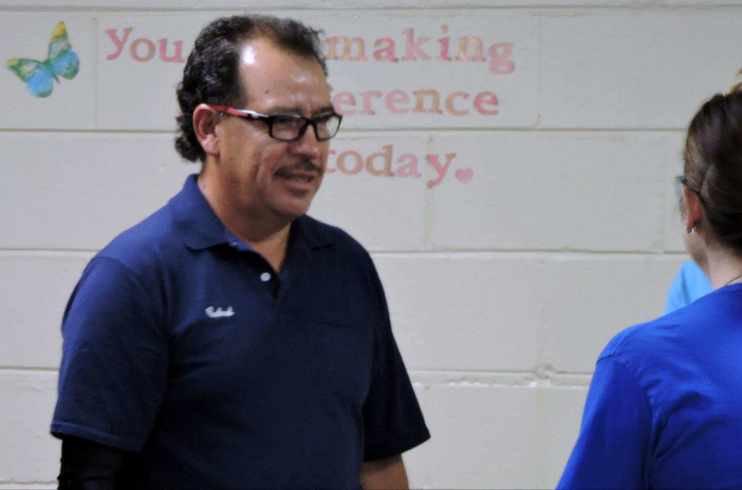 Custodian Alfonso Rivera will be recognized with the Illinois State Board of Education's highest honor on Oct. 19 in Normal, Illinois.