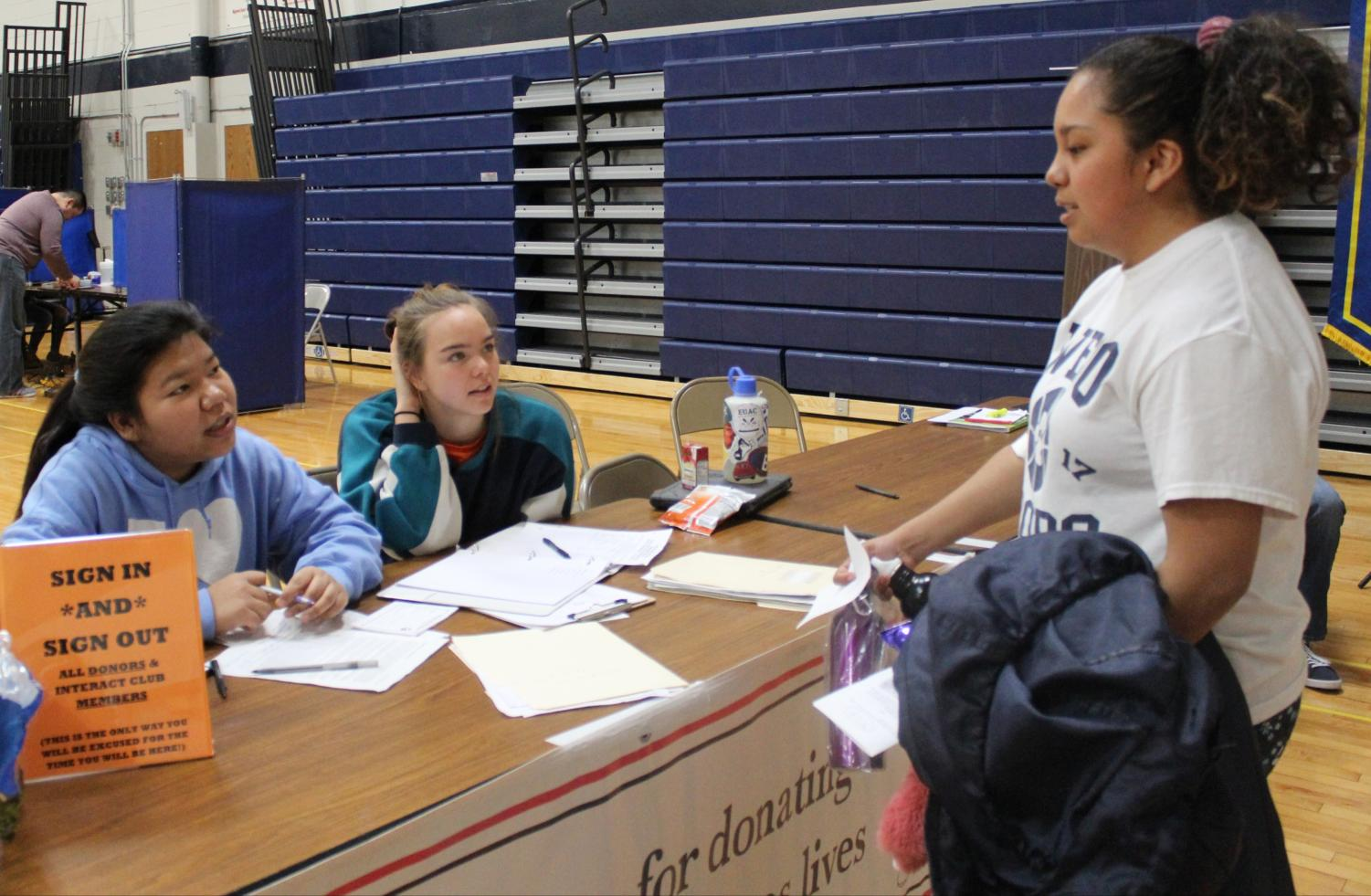 Junior Guadalupe Rosales meets with Interact members Flora Nei ('19) and Ruby Lebo at last year's spring blood drive.