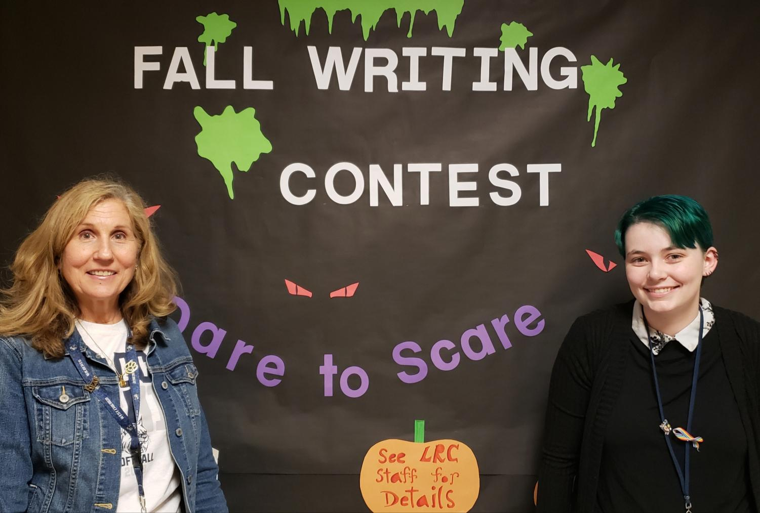 Library media specialist Donna Leahy (left) presents Dare to Scare on Oct. 24. LRC clerk Donna Kubica designed the poster.