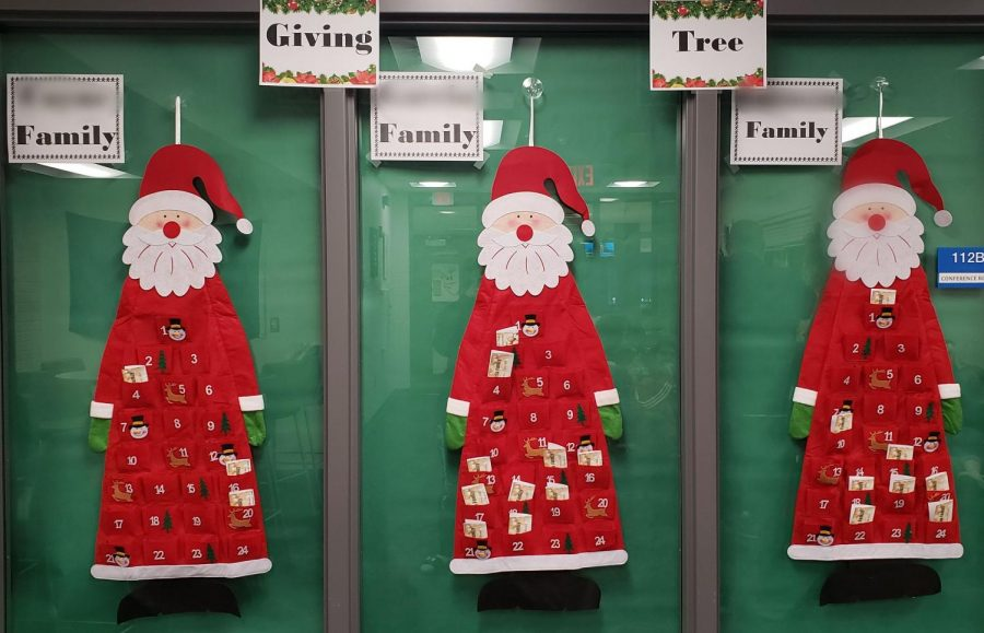 Three+trees+with+gift+requests+are+hung+up+in+the+student+activity+center+as+a+way+for+staff+to+donate+to+families+in+need+for+the+holidays.+Deadline+to+leave+gifts+is+Dec.+11.+