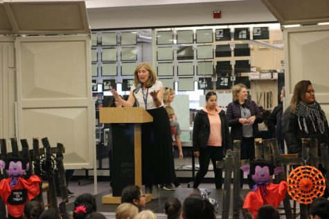 In 2019, librarian Donna Leahy speaks at the Dare to Scare event in front of students.