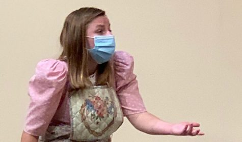 Junior Maggie Hancock adheres to CDC guidelines, wearing a mask while performing.