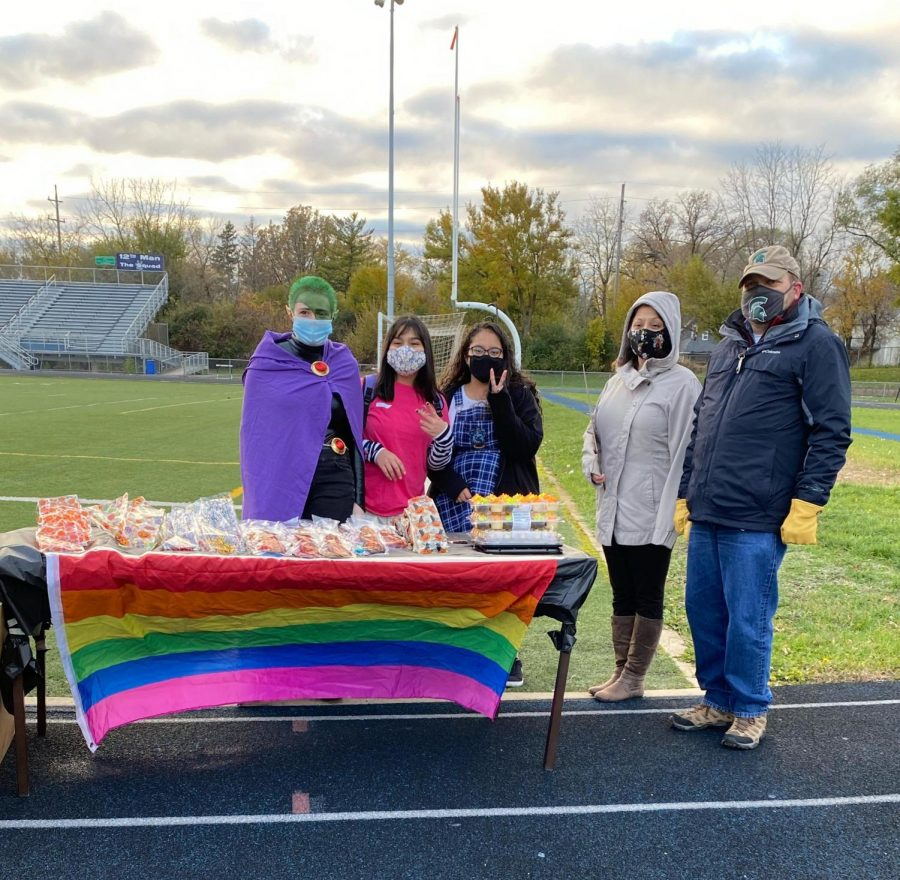 GSA members and sponsors Brad Larson and Christina Sladek share treats at the Track or Treat event in October.