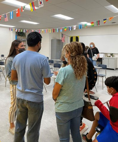Spanish teacher Elizabeth Mastroianni meets with parents during the open house.