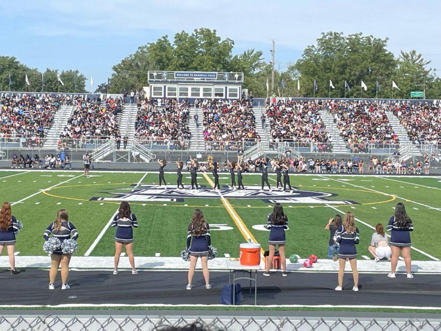 Cheerleaders stunt on the new field.